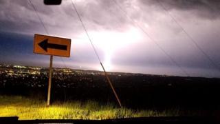 A lightning strike seen through a car windshield