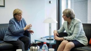 Angela Merkel (left) and Theresa May
