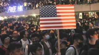 Protesters in Hong Kong with US flag