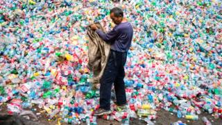 A Chinese worker sorting out plastic bottles for recycling on the outskirts of Beijing.