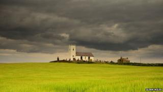 Storm clouds over Ballintoy church