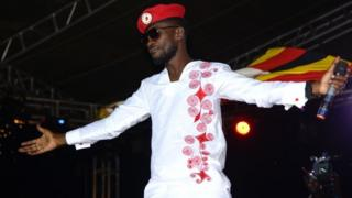 Bobi Wine appears on stage on the outskirts of Kampala