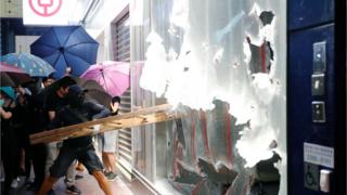 Hong Kong: Face mask ban prompts thousands to protest
