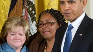 Judy Shepard (L) at the White House for the passage of the anti-hate crimes bill jointly named after her son