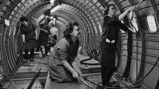 Cleaners inside Concorde