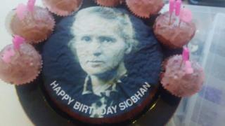 Cake with the face of Marie Curie on it