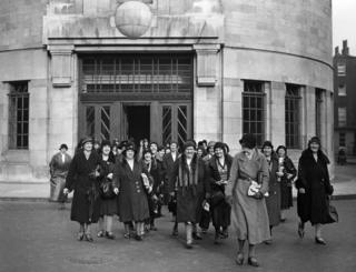Cleaners leaving the BBC, October 1932