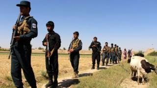 Afghan security officials on patrol in Helmand (08 June 2017)