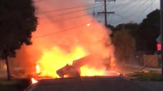 A handout screenshot taken from a supplied video shows a light plane on fire after crashing onto a street in Mordialloc, Melbourne, Victoria, Australia, 08 June 2018