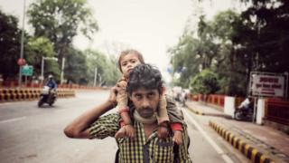 A migrant worker with his daughter