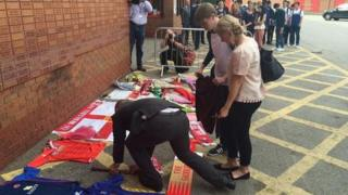 People paying tribute in Walsall