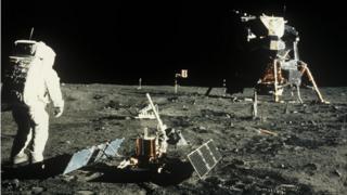 Buzz Aldrin near the scientific equipment