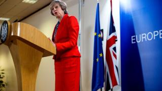 Theresa May addresses journalists in Brussels