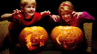 Children with pumpkins.