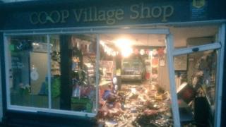 A car inside the Lavenham Co-op Village Shop