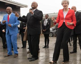 Prime Minister Theresa May dancing at ID Mkhize Secondary School in Gugulethu, Cape Town, South Africa - Tuesday 28 August 2018