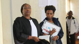 Violette Uwamahoro with one of her lawyers