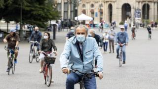 People ride bicycles outdoors on the first Sunday of Phase 2 during the coronavirus emergency, in Verona, northern Italy, 10 May 2020