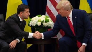 US President Donald Trump and Ukrainian President Volodymyr Zelensky shake hands during a meeting in New York on 25 September 2019,