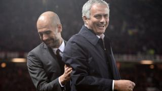 Pep Guardiola and Jose Mourinho share a joke on the touchline.