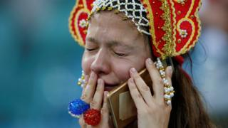 Russian fan cries at the end of the team's quarter-final match against Croatia, 7 July 2018