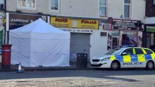Police forensic tent at scene