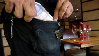 Worker with money pouch