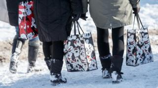Shoppers waling in the snow