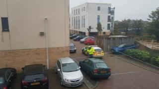 Sandhurst Place with a police car outside