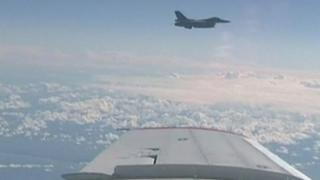 Screengrab purportedly showing a Nato fighter jet close to a Russian plane carrying the defence minister