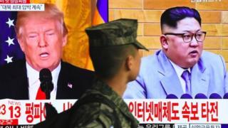 تصویر ترامپ و کیم و سرباز کره جنوبی