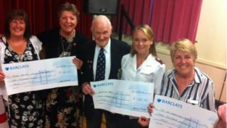 Cyril Banks and charity representatives