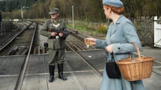 A World War II re-enactor dressed as a German soldier at Levisham Station, near Pickering