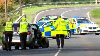 Police reviewing the crash scene