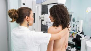Young woman gets breasts checked