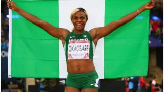Blessing Okagbare as she carry Nigerian flag dey celebrate