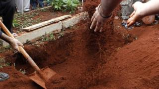 A file picture shows a body being buried in Kenya's capital Nairobi on 22 September, 2013