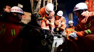 """In this Dec. 28, 2015 photo provided by China""""s Xinhua News Agency, rescuers try to contact the trapped people at a collapsed mine in Pingyi County, east China""""s Shandong Province."""