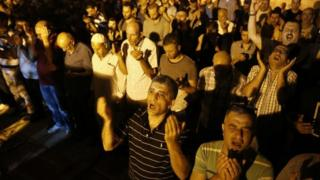 Palestinian Muslim worshippers pray outside Jerusalem's Old City on 25 July 2017
