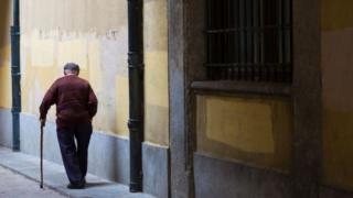 Elderly man walking away