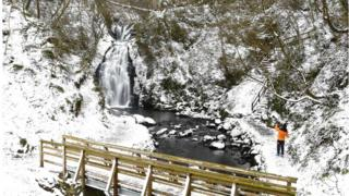 There has been more snow in Northern Ireland over the weekend as seen here at Glenoe Waterfall in County Antrim