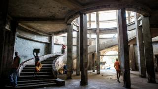 People in the staircase of The Grande Hotel in Mozambique's coastal city of Beira