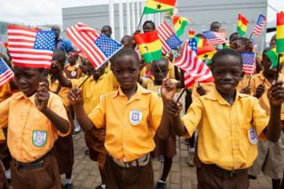 Children wave the American and Ghana flags for US First Lady Melania Trump during an arrival ceremony after landing at Kotoka International Airport in Accra October 2, 2018 as she begins her week long trip to Africa to promote her 'Be Best' campaign.