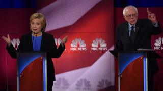Democratic presidential candidates, former Secretary of State Hillary Clinton (L) and Vermont Senator Bernie Sanders (R) participate in the NBC News -YouTube Democratic Candidates Debate on January 17, 2016