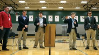 Tyler Ruzich (2ndR), 17, flanked by Ethan Randleas (L), 17, and Jack Bergeson (3rdL), 16, and his running mate Lt Governor Candidate Alexander Cline (2ndL) and Dominic Scavuzzo, 17, (R), speaks during a forum.