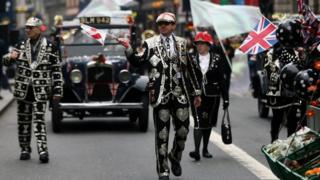 "Members of Pearly Kings and Queens take part in the New Year""s Day Parade in London"