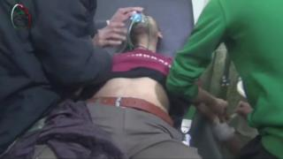 Video purportedly showing a Syrian man being treated by medics after what activists said was an attack by government forces on the Damascus suburb of Muadhamiya on 22 December 2015