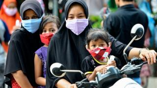 People wearing face masks, amid concerns over the coronavirus outbreak, in Banda Aceh, Indonesia - 7 April 2020
