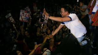 Panthongtae Shinawatra, son of former Prime Minister Thaksin Shinawatra, greeting supporters of the Pheu Thai Party in February