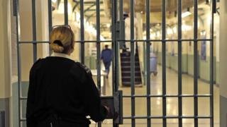 Prisoner officer locks door